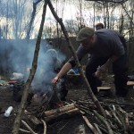 Lighting a fire to cook nettle curry
